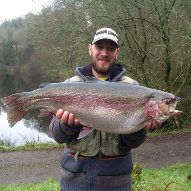 Kevin Keast from Plymouth with his 18lbs-6oz rainbow caught on a Walkers Mayfly nymph.